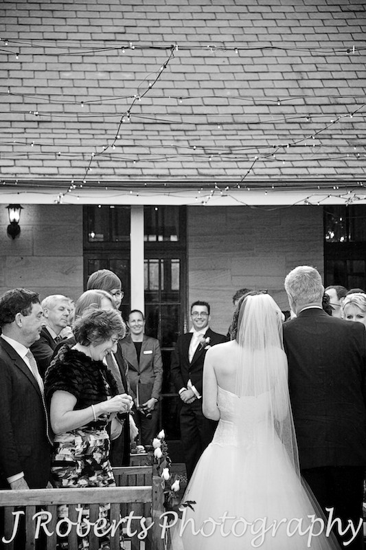 Groom looking at Bride walking down the aisle at Gunners' Barracks Courtyard - wedding photography sydney