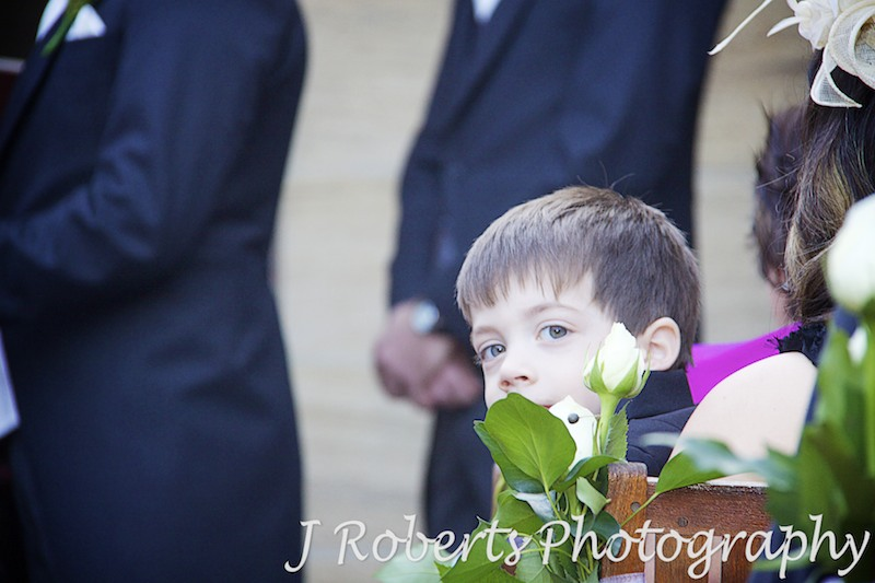 Paige boy cheeky look over shoulder at wedding - wedding photography sydney