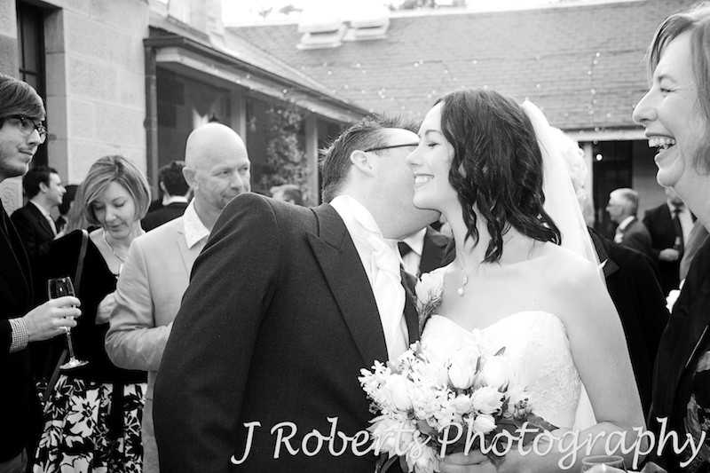 Groom kissing bride following the ceremony - wedding photography sydney
