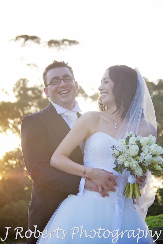 Bride and groom laughing at sunset - wedding photography sydney