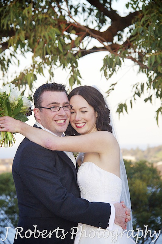 Bride and groom hugging at Georges Heights - wedding photography sydney