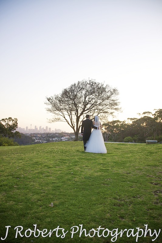 Bride and groom walking into the sunset at Georges Head Mosman - wedding photography sydney