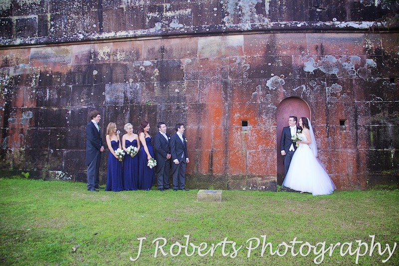 Bridal party in front of orange lichen historic wall at Gunners' Barracks Mosman - wedding photography sydney
