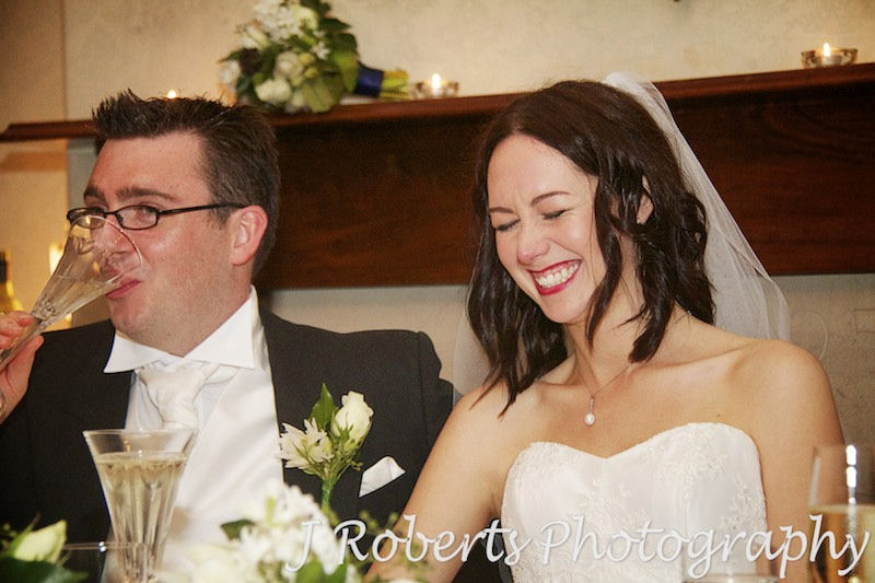 Bride laughing at speeches - wedding photography sydney