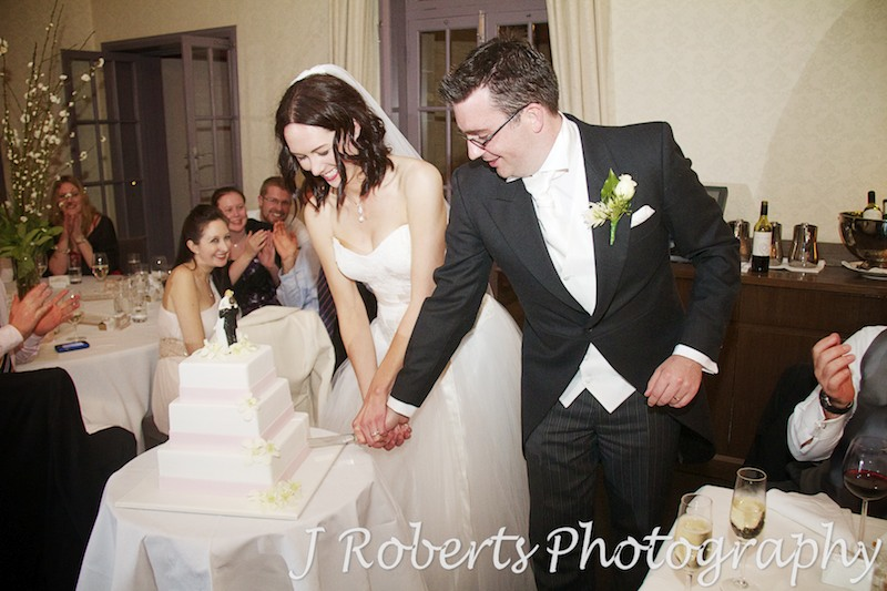 Bride and groom cutting the cake - wedding photography sydney
