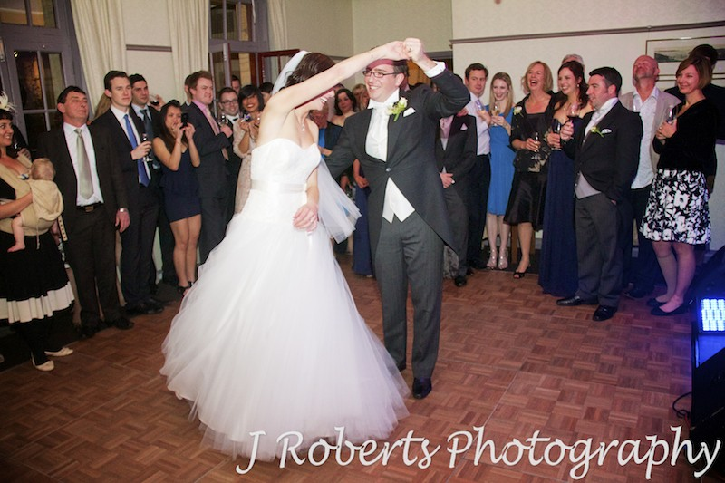 Bride being twirled by the groom during bridal waltz - wedding photography sydney