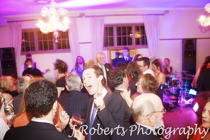 Partying guests on the dance floor - wedding photography sydney
