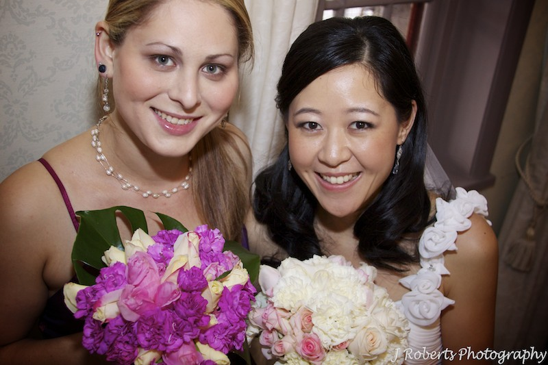 Bride with bridesmaid - wedding photography sydney