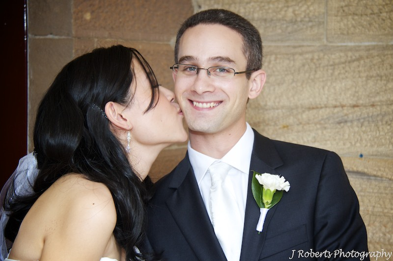 Bride kissing groom - wedding photography sydney