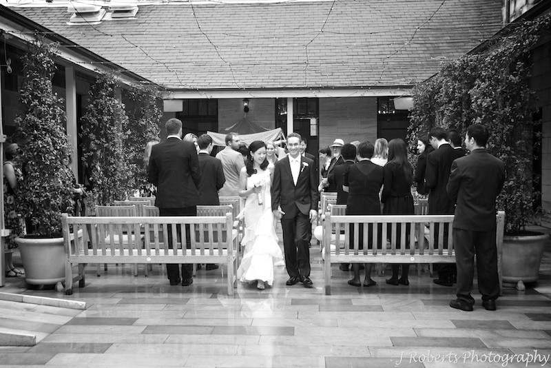 bride and groom walking down the aisle - wedding photography sydney