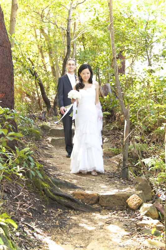 Bride and groom walking bush track - wedding photography sydney