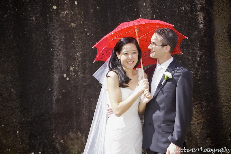 Chinese bride with red umbrella - wedding photography sydney