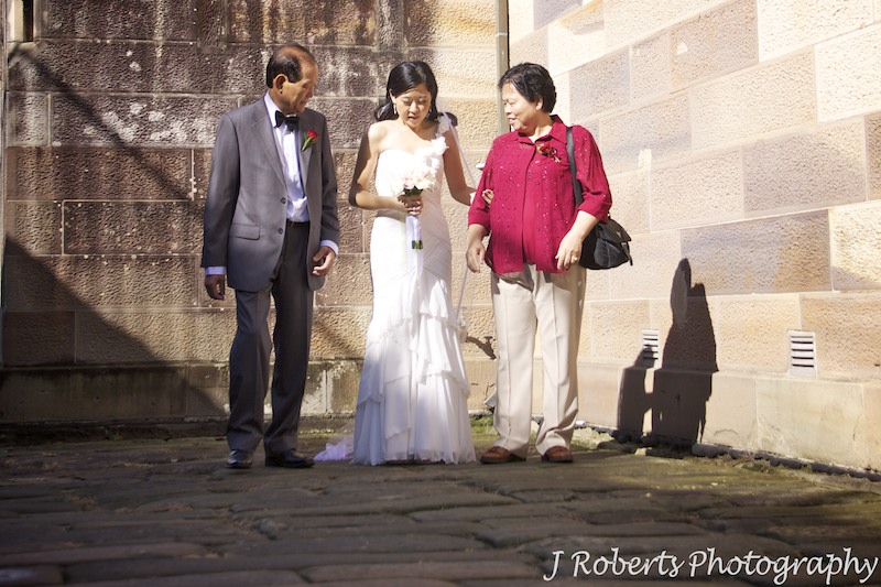 Bride preparing to walk down aisle with mother and father - wedding photography sydney