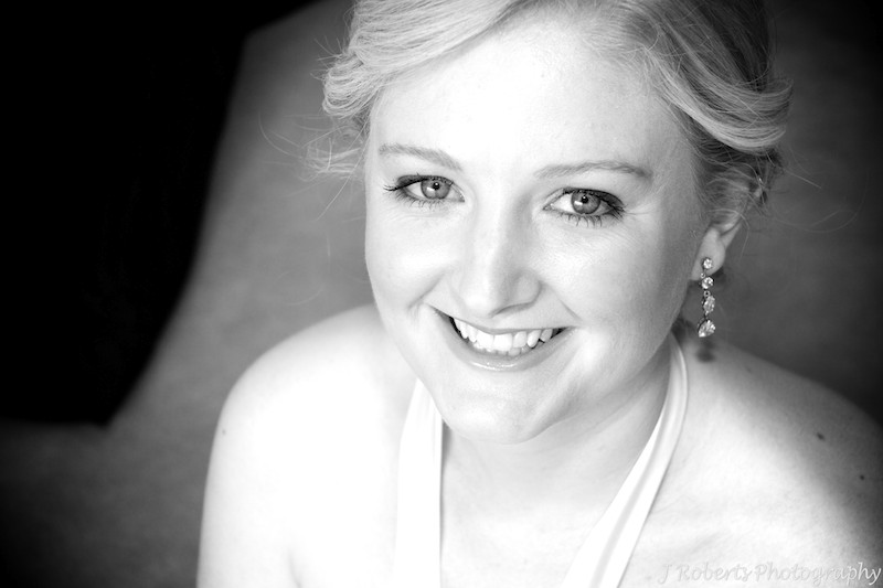 B&W bride smiling up at camera - wedding photography sydney