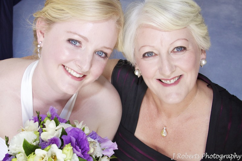 Bride and her mother beaming at the camera - wedding photography sydney