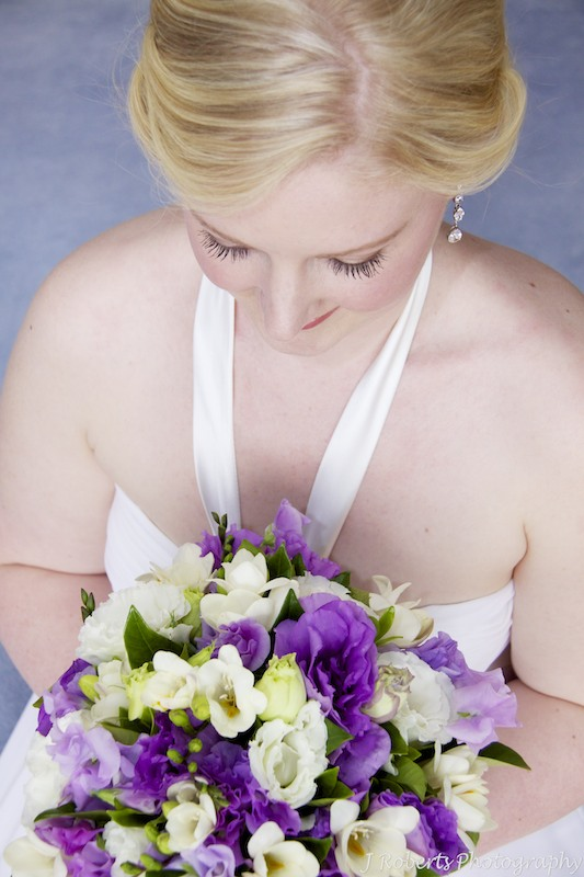 Bride looking down at her flowers - wedding photography sydney