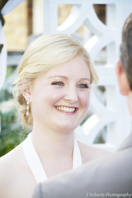Bride laughing during ceremony - wedding photography sydney