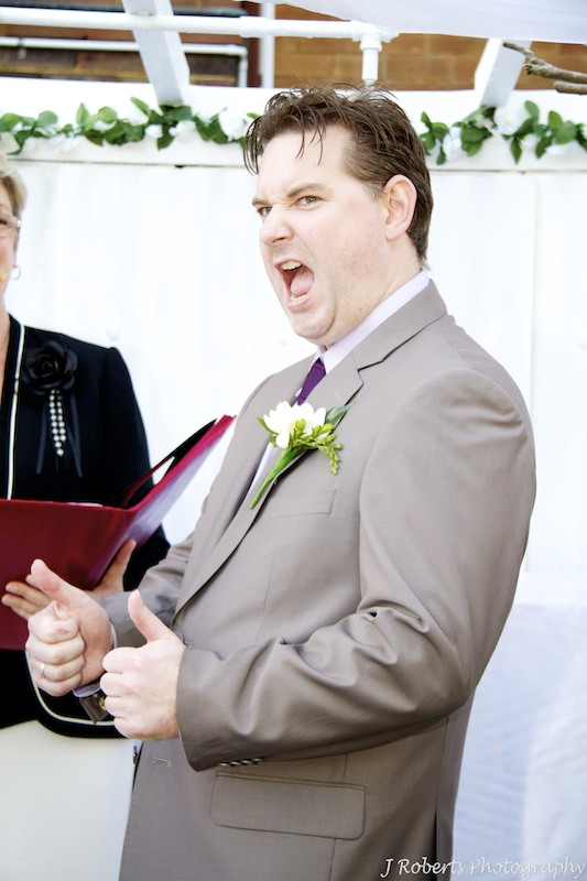 Groom cheering during ceremony - wedding photography sydney