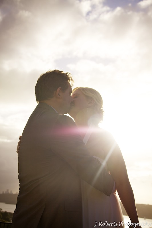 Bride & Groom kissing in the sunset - wedding photography sydney