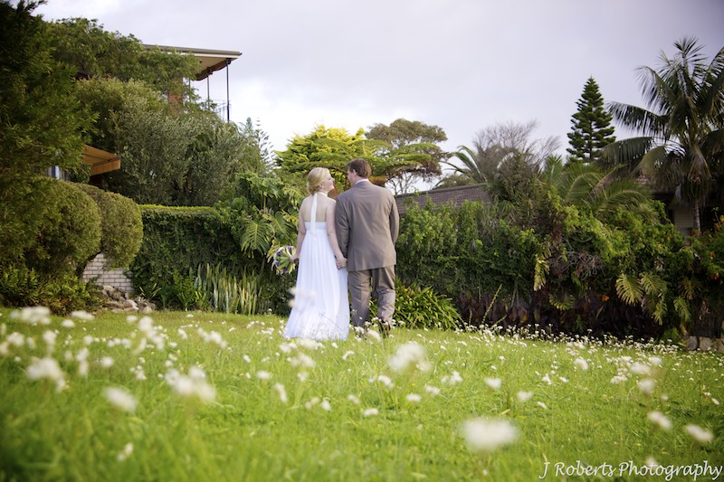 Bride and groom walking in park - wedding photography sydney