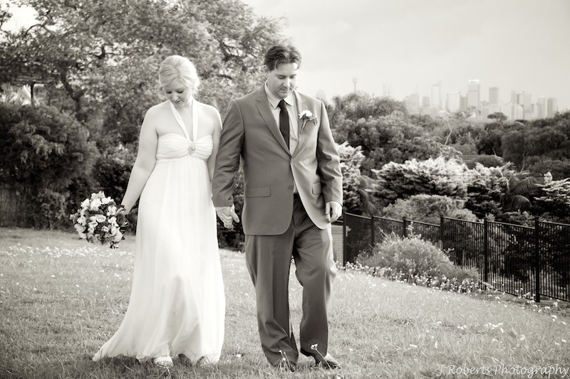 Sepia bride and groom walking at sunset - wedding photography sydney