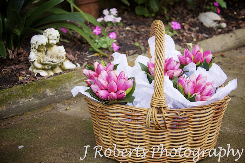 Flower girl bouquets in basket - wedding photography sydney