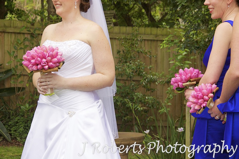 Bride and bridesmaids holding pink tulip bouquets - wedding photography sydney