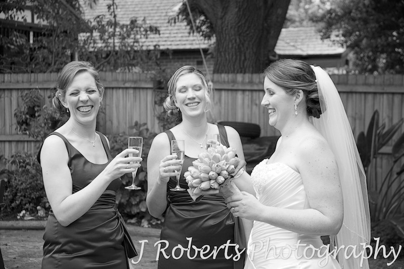 Bride laughing with bridesmaids and champagne - wedding photography sydney