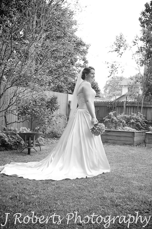 B&W of bride standing in garden - wedding photography sydney