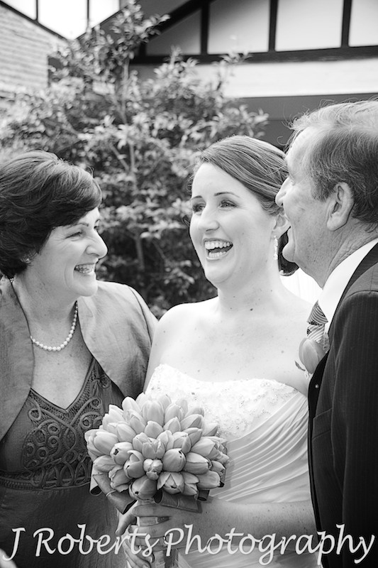 Bride laughing parents outside family home Eastwood - wedding photography sydney