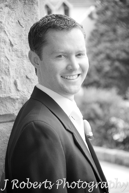 B&W of groom smiling at camera - wedding photography sydney