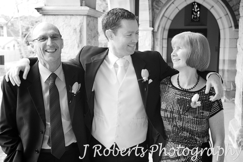 Groom laughing with his parents - wedding photography sydney