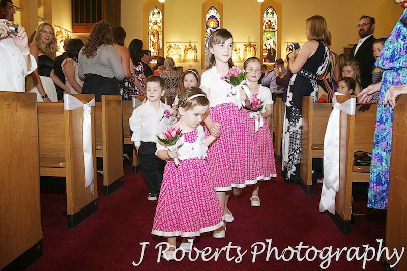 Flower girls and page boy coming down the aisle - wedding photography sydney