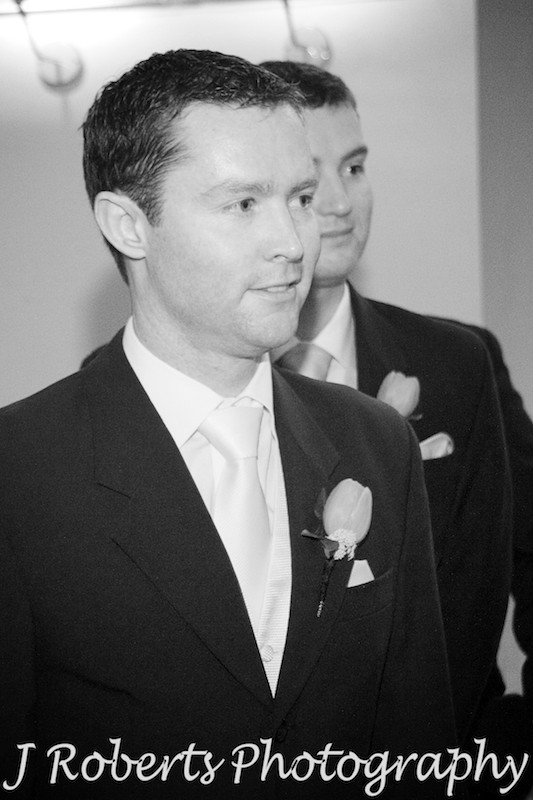 Groom smiling at bride coming down the aisle - wedding photography sydney