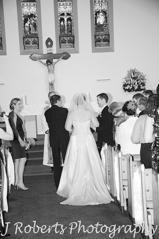 Father of the bride handing over her hand in marriage - wedding photography sydney