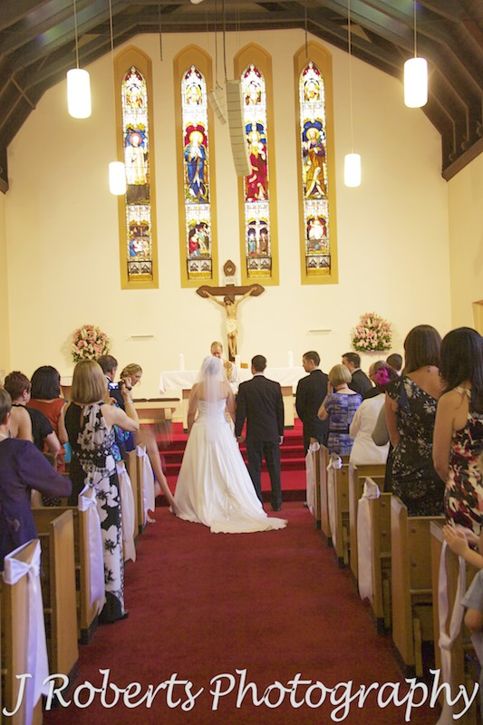 Bride and groom join in St Francis Xavier Church Lavender Bay - wedding photography sydney