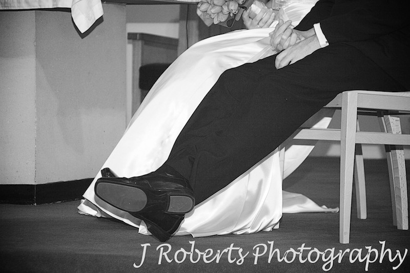 Groom lounging back in church - wedding photography sydney