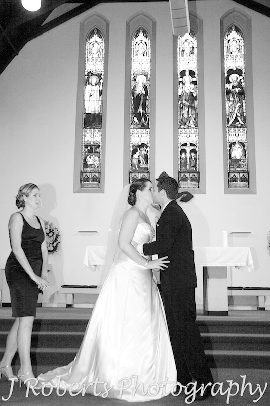 Couples first kissing after marriage ceremony - wedding photography sydney
