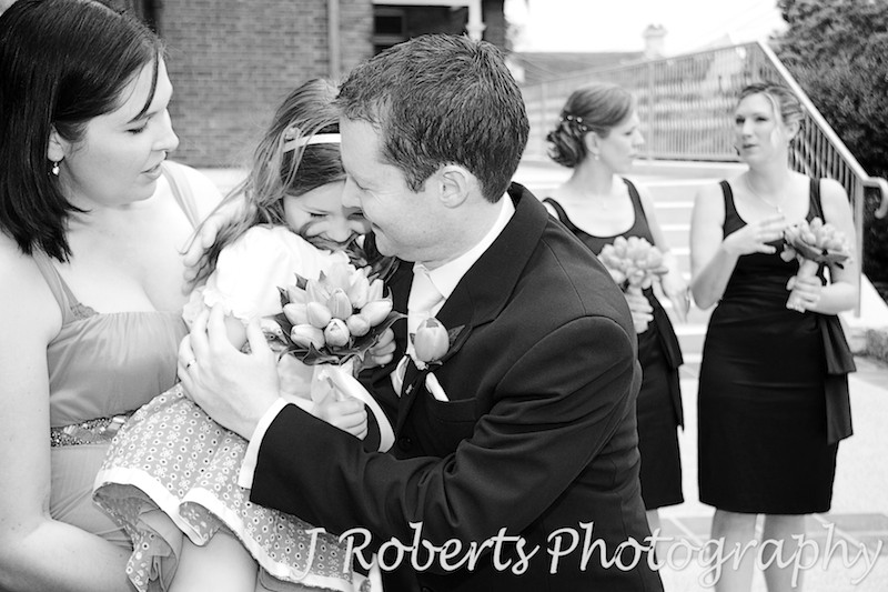 Flower girl hugging groom - wedding photography sydney