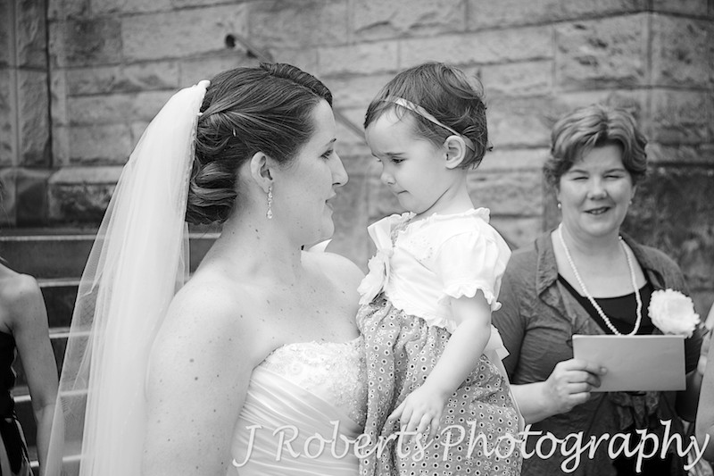 Bride chatting to little flower girl - wedding photography sydney