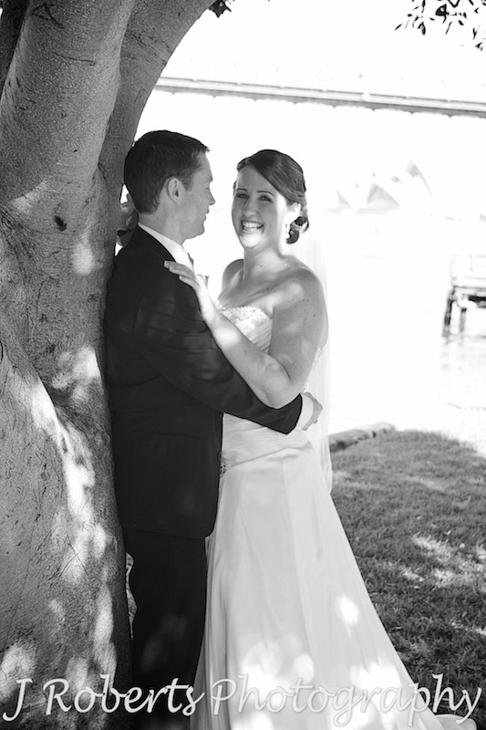Bride laughing in grooms arms - wedding photography sydney