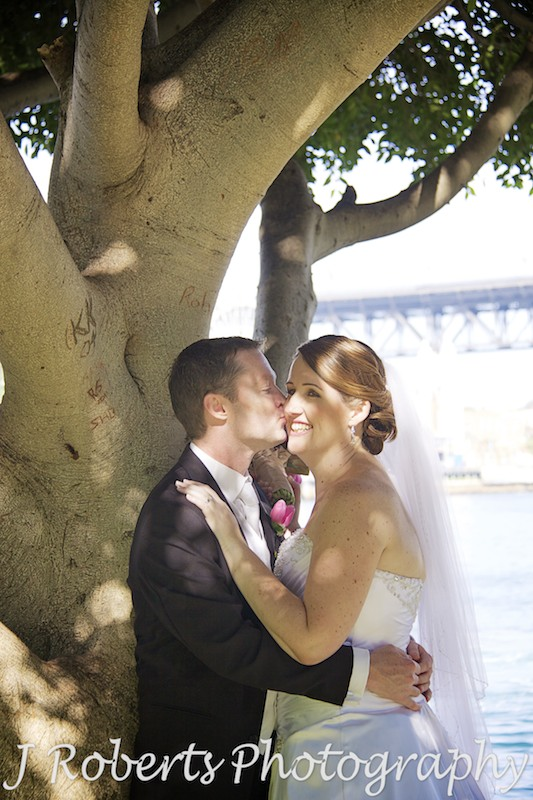 Groom kissing brides cheek - wedding photography sydney
