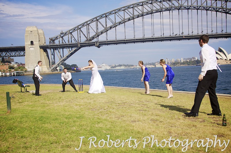 Bridal party playing backyard cricket on Sydney Habour Foreshore - wedding photography sydney