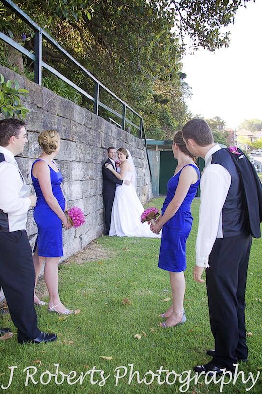 Bride and groom smiling back at bridal party - wedding photography sydney