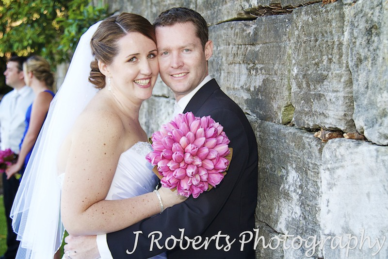 Bride and groom smiling cheek to cheek - wedding photography sydney