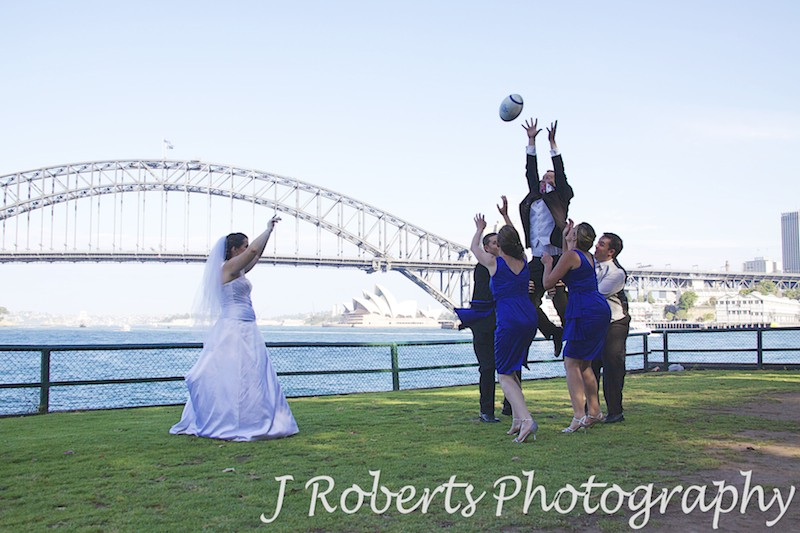 Bridal party rugby line out at Blues Point - wedding photography sydney