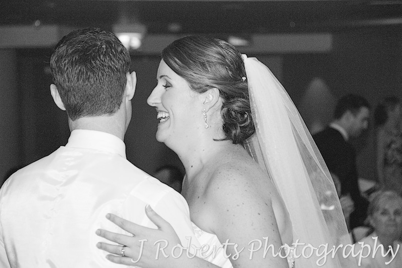 Bride laughing during bridal waltz - wedding photography sydney