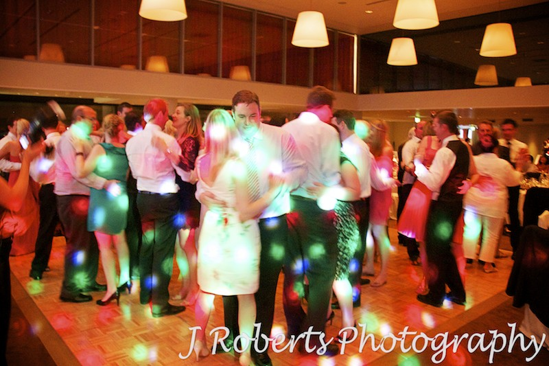 Packed dance floor at wedding reception at the Kirribilli Club  - wedding photography sydney