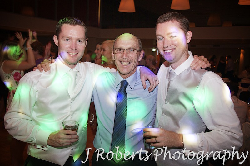 Father and 2 sons on dance floor at wedding reception - wedding photography sydney