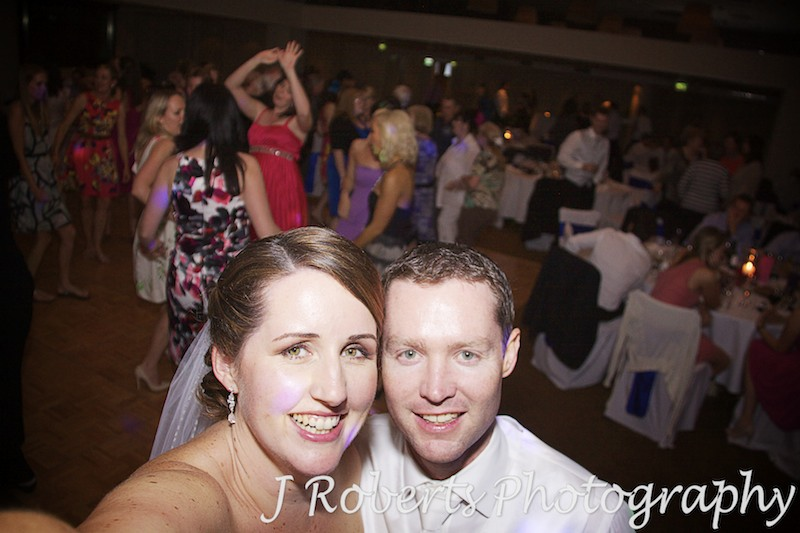 Bride and groom self portrait on dance floor at wedding reception - wedding photography sydney